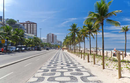 Ipanema beach with mosaic of sidewalk in Rio de Janeiro photo