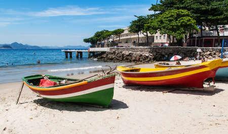 brazil beach: Two boats on the Copacabana beach and Fort of Copacabana in Rio de Janeiro