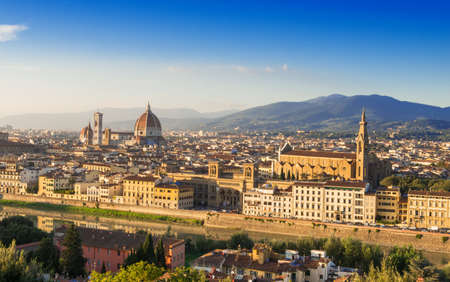 Sunset aerial view of Florence with Cathedral of Santa Maria del Fiore  Duomo  , Palazzo Vecchio and Ponte Vecchio  Italy  photo