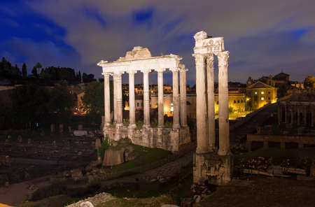 obelisc: Night view of Temple of Saturn  Forum Romanum in Rome, Italy Stock Photo