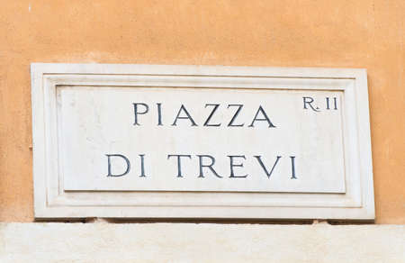 street name sign: Street plate of famous Piazza Di Trevi in Rome, Italy