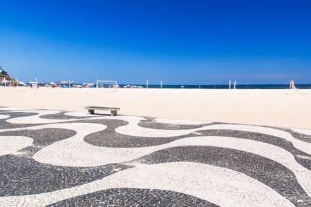 View of Copacabana beach with mosaic of sidewalk in Rio de Janeiro Stock Photo