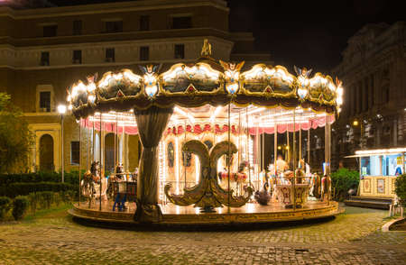 merry go round: Merry-Go-Round illuminated at night in Rome Stock Photo