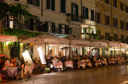 navona: Night view of restaurants on Piazza Navona in Rome, Italy