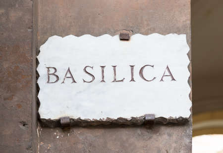 street name sign: Old street plate  Basilica  in Aventine Hill in Rome, Italy