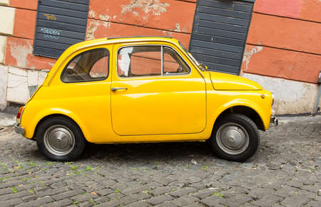 Fiat 500 parked in Rome, Italy  스톡 콘텐츠