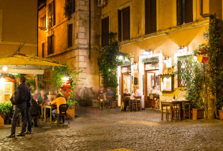 street cafe: Old street in Trastevere in Rome, Italy
