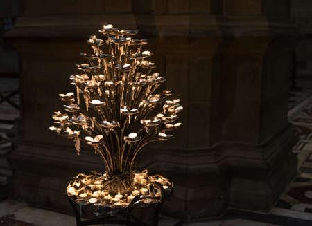 requesting: Lighted candles in Basilica di Santa Maria del Fiore, Duomo, Florence, Italy
