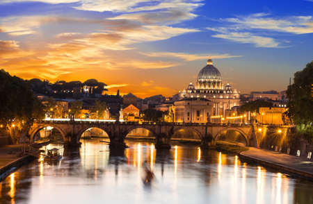 tevere: Sunset view of Basilica St Peter and river Tiber in Rome in Italy Stock Photo