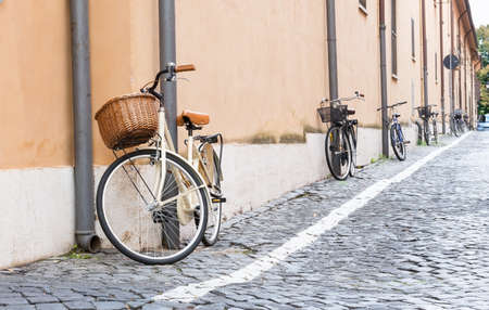 cobble: Bicycles parked on the street in Rome, Italy