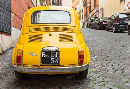 Fiat 500 parked in Rome, Italy  Redakční