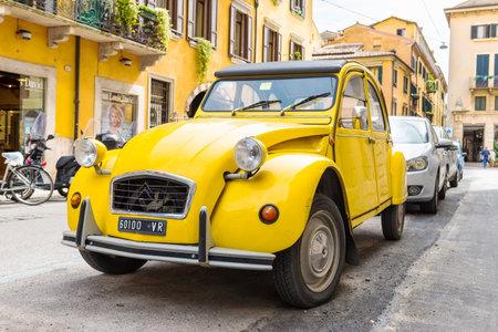 yellow car: Citroen 2CV parked on the street of Verona, Italy