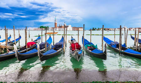 san marco: Gondolas moored by San Marco square, Venice, Italy