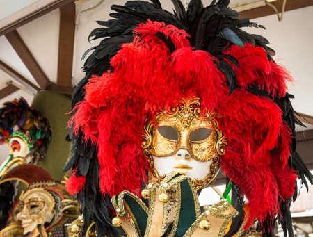 masquerader: Venetian carnival mask, Venice. Italy