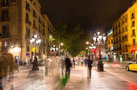 Night view of La Rambla street at the heart of Barcelona, Spain