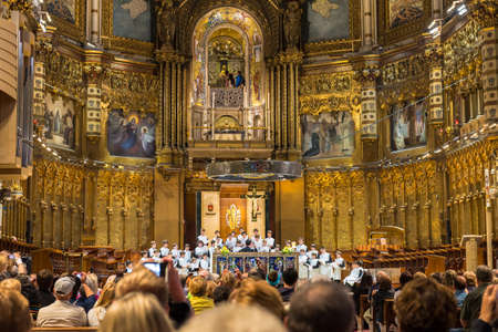 spiritual journey: Perfomance of Montserrat Boys Choir in Basilica in Benedictine Abbey of Santa Maria de Montserrat in Montserrat, Spain.