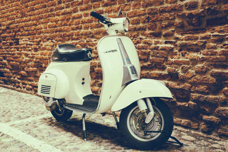 old street: Old Vespa parked on old street in Verona, Italy Editorial