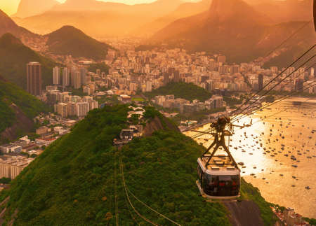 Sunset view of Botafogo, mountain Urca and cable car to mountain Sugar Loaf in Rio de Janeiro. Brazil