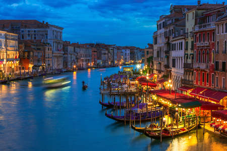 italy street: Night view of Grand Canal with gondolas in Venice. Italy