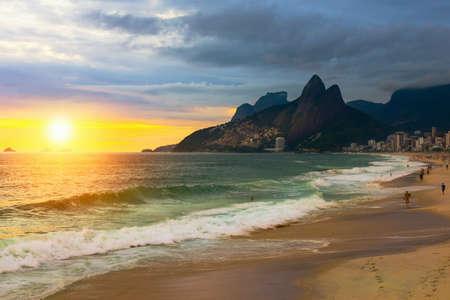 Sunset view of Ipanema beach and mountain Dois Irmao (Two Brother) in Rio de Janeiro, Brazil. Ipanema beach is the most famous beach of Rio de Janeiro