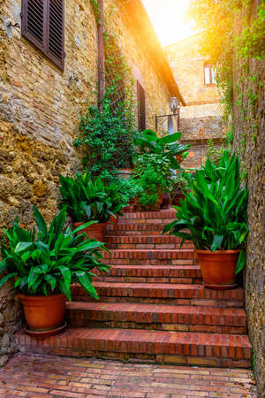 tuscana: Old street in San Gimignano, Tuscany, Italy. San Gimignano is typical Tuscan medieval town in Italy