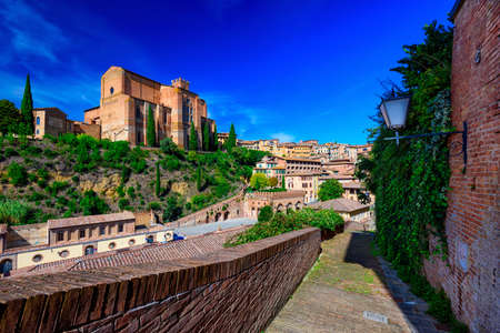 View of Siena and Basilica of San Domenico (Basilica Cateriniana) is basilica church in Siena, Tuscany, Italy, one of the most important of Siena. Stock Photo