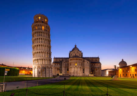 Night view of Pisa Cathedral (Duomo di Pisa) with the Leaning Tower of Pisa (Torre di Pisa) on Piazza dei Miracoli in Pisa, Tuscany, Italy
