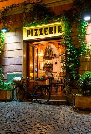 Old cozy street at night in Trastevere, Rome, Italy.