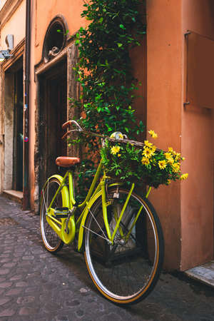 cobble: Bicycle parked on the street in Rome, Italy