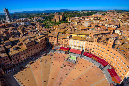 Aerial view of Siena, Campo Square (Piazza del Campo) and Siena Duomo in Siena, Tuscany, Italy Stock Photo