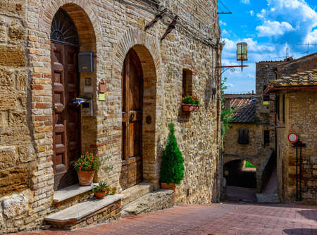 tuscana: Old cozy street in San Gimignano, Tuscany, Italy. San Gimignano is typical Tuscan medieval town in Italy