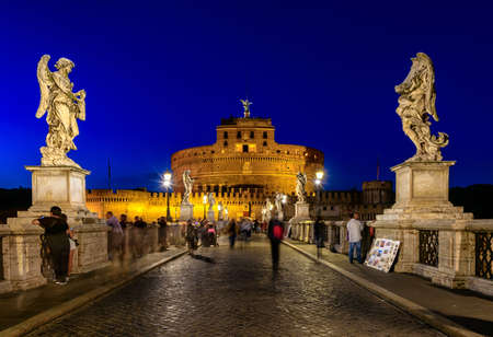tevere: Night view of Castle Sant Angelo (Mausoleum of Hadrian), bridge Sant Angelo and river Tiber in Roma. Italy Stock Photo