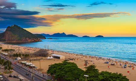 sugar palm: Sunset view of Copacabana beach and Avenida Atlantica in Rio de Janeiro, Brazil