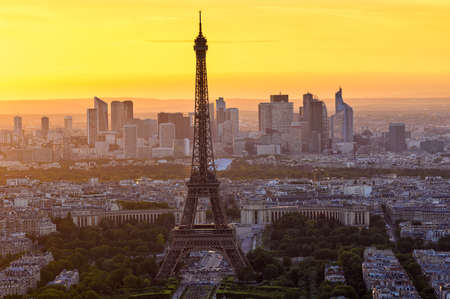 champ: Skyline of Paris with Eiffel Tower at sunset in Paris, France