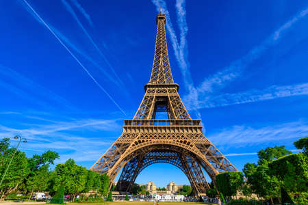 Paris Eiffel Tower and Champ de Mars in Paris, France. Eiffel Tower is one of the most iconic landmarks in Paris. The Champ de Mars is a large public park in Paris. Stock Photo