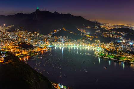 Night view of Corcovado, Botafogo, and Guanabara bay in Rio de Janeiro. Brazil Stock Photo