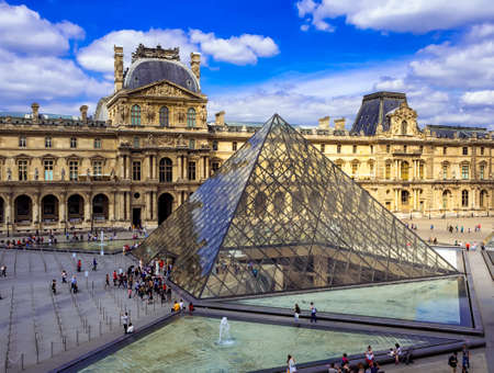 Paris, France - May 24, 2017: The Louvre Museum and Louvre Pyramid in Paris. The Louvre Museum is the worlds largest museum in Paris, France