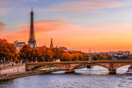 Sunset view of Eiffel tower and Seine river in Paris, France. Autumn Paris