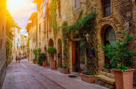 Old street in San Gimignano, Tuscany, Italy. San Gimignano is typical Tuscan medieval town in Italy