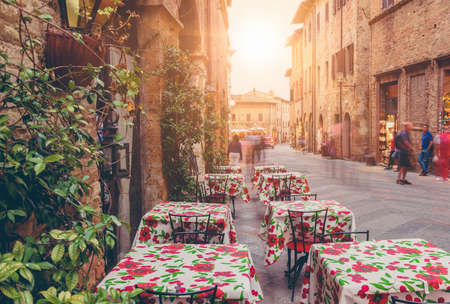Old street in San Gimignano in evening, Tuscany, Italy. San Gimignano is typical Tuscan medieval town in Italy
