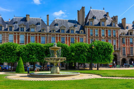 Place des Vosges (Place Royale)  is the oldest planned square in Paris and one of the finest in the city. It is located in the Marais district in Paris, France Stock Photo