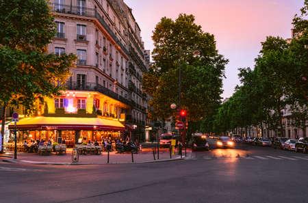 Old street in Paris, France. Night cozy cityscape of Paris.