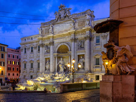 Night view of Rome Trevi Fountain (Fontana di Trevi) in Rome, Italy. Trevi is most famous fountain of Rome. Architecture and landmark of Rome