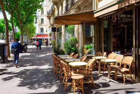 Boulevard Saint-Germain with tables of cafe in Paris, France. Boulevard Saint-Germain is a major street in Paris. Stok Fotoğraf