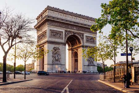 Paris Arc de Triomphe (Triumphal Arch) in Chaps Elysees at sunset, Paris, France.