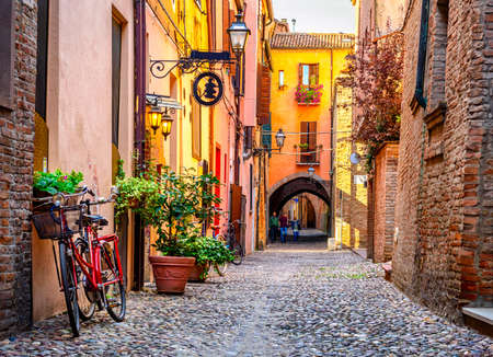 Cozy narrow street in Ferrara, Emilia-Romagna, Italy. Ferrara is capital of the Province of Ferrara 免版税图像