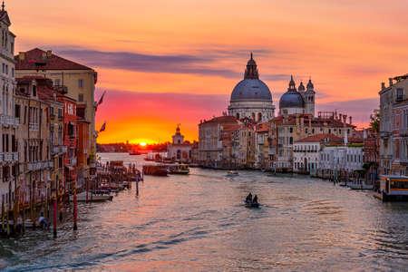 Grand Canal with Basilica di Santa Maria della Salute in Venice, Italy. Sunrise view of Venice Grand Canal. Architecture and landmarks of Venice. Venice postcard Imagens