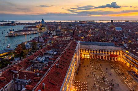 Aerial sunset view of Venice, Grand Canal and Basilica di Santa Maria della Salute, Piazza San Marco in Venice, Italy. Architecture and landmarks of Venice. Venice postcard