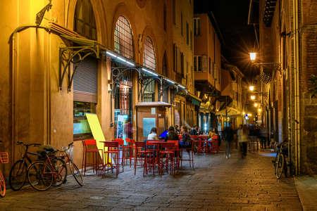 Old narrow street in Bologna, Emilia Romagna, Italy. Night cityscape of Bologna.