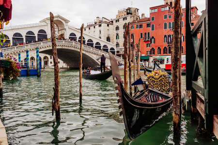 Rialto bridge and Grand Canal in Venice, Italy. View of Venice Grand Canal with gandola. Architecture and landmarks of Venice. Venice postcard